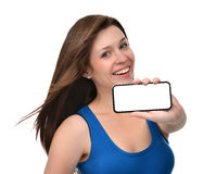 Young woman show display of mobile cell phone with blank screen Royalty Free Stock Photos