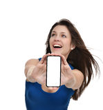 Young woman show display of mobile cell phone with blank screen Stock Photos