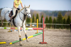 Young woman show jumping Stock Photo