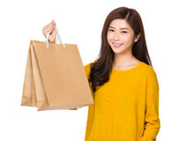 Young woman show with paper bag Royalty Free Stock Image