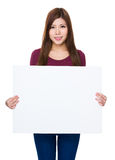Young woman show with white poster Royalty Free Stock Photography