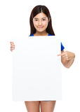 Young woman show with the white poster Stock Photography