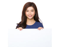 Young woman show the whte poster Royalty Free Stock Photos