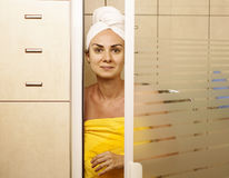 Young woman in the shower cabin Stock Images