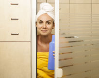 Young woman in the shower cabin with a shower gel Royalty Free Stock Image