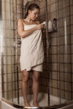 Young woman after a shower in a towel Stock Image
