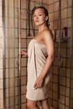 Young woman after a shower in a towel Stock Images