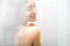 Young woman showering Royalty Free Stock Image