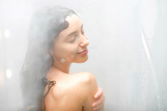 Young woman showering Stock Photo