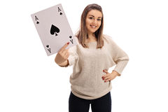 Young woman showing an ace of spades card. On white background Stock Photography