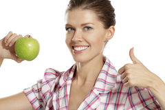 Young woman showing apples Stock Images