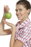Young woman showing apples Stock Photography