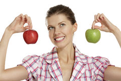 Young woman showing apples Stock Photo