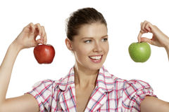 Young woman showing apples Stock Photos