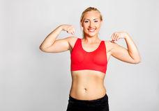 Young woman showing biceps Royalty Free Stock Photo
