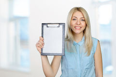 Young woman showing blank clipboard Stock Photography