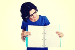 Young woman showing blank pages of her notebook Stock Image