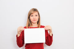 Young Woman showing a blank sheet of paper Stock Photos