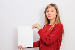 Young Woman showing a blank sheet of paper Royalty Free Stock Image