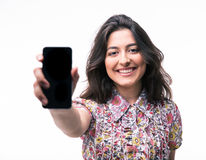 Young woman showing blank smartphone screen Royalty Free Stock Photography