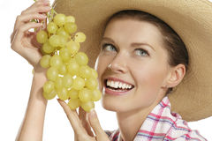 Young woman showing a bunch of grapes Stock Image