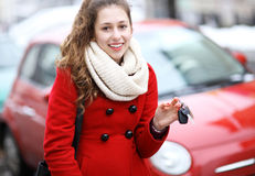 Young woman showing car key Royalty Free Stock Photo