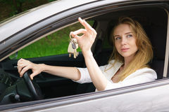 Young woman showing car key Royalty Free Stock Images