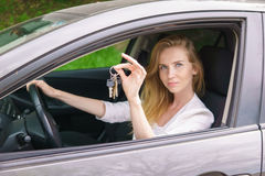 Young woman showing car key Stock Photography
