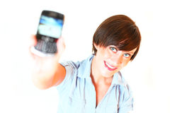 Young woman showing cellphone cut out. Blurred Royalty Free Stock Images