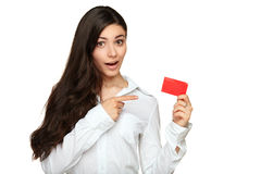 Young woman showing copy space on empty blank sign. Girl pointing at gift card sign. Young beautiful woman showing copy space on empty blank sign or gift card Royalty Free Stock Image