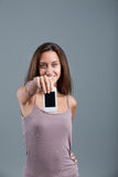 Young woman showing COPY SPACE phone Royalty Free Stock Photos