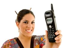 Young woman showing cordless phone Royalty Free Stock Photos