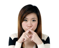 Young woman showing crossed sign with her fingers Royalty Free Stock Images
