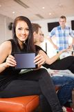 Young Woman Showing Digital Tablet in Bowling Club Stock Images