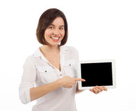 Young woman showing a digital tablet Royalty Free Stock Photo