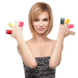 Young woman showing eight bottles of nail polish Stock Photos