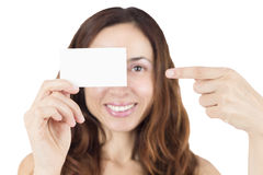 Young woman showing an empty white sign card Royalty Free Stock Photos