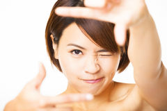 Young Woman showing frame finger Royalty Free Stock Images