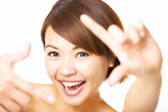 young Woman showing frame finger sign Royalty Free Stock Images