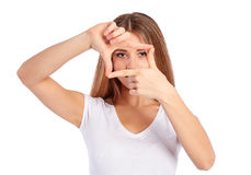 Young woman is showing frame by hands Stock Images