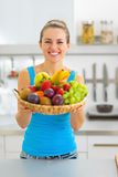 Young woman showing fruits plate Royalty Free Stock Photo