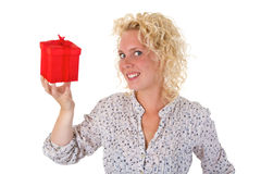 Young woman showing a gift Stock Images