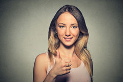 Young woman showing giving thumbs up Royalty Free Stock Photo
