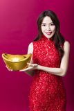Young woman showing  gold for chinese new year Stock Photography