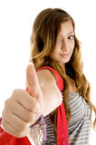 Young woman showing goodluck sign Stock Photos