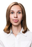 Young woman showing grimace with tongue. Young funny woman showing grimace with tongue isolated on white background stock photography