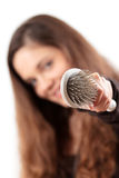 Young woman showing hairbrush Royalty Free Stock Photography