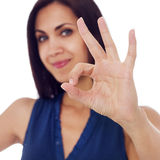 Young woman showing hand ok sign Royalty Free Stock Images