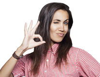 Young woman showing hand ok sign Stock Photo