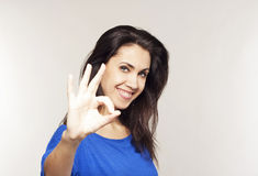 Young woman showing hand ok sign Royalty Free Stock Photos